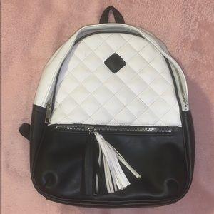 A mini backpack black and white